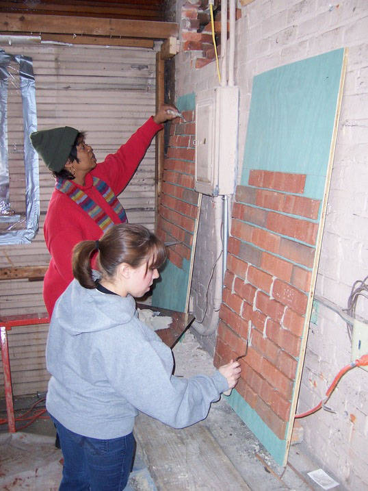 Students working on historic preservation brick restoration