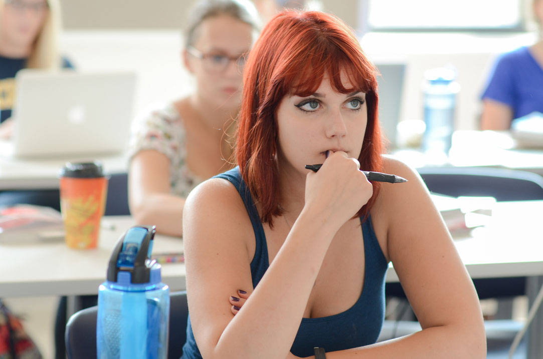 Student listens intently to professor during class