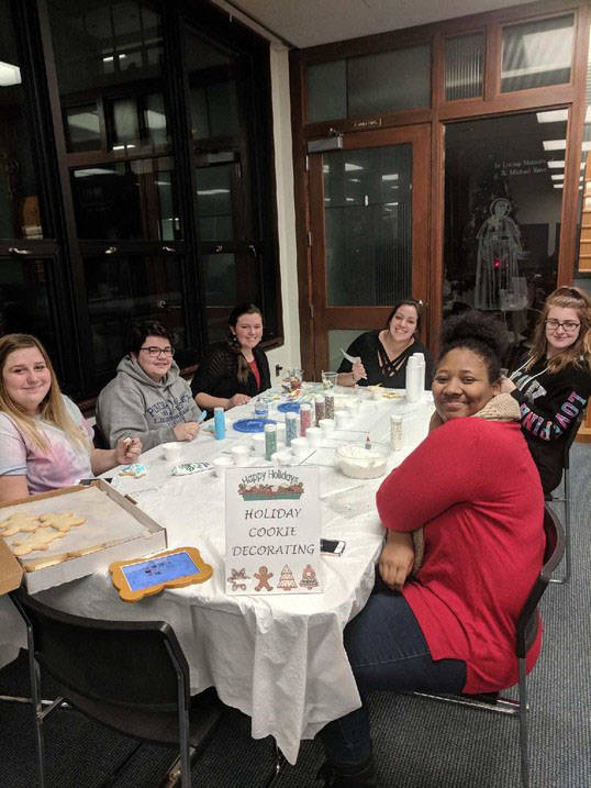 Ursuline students decorate Christmas cookies