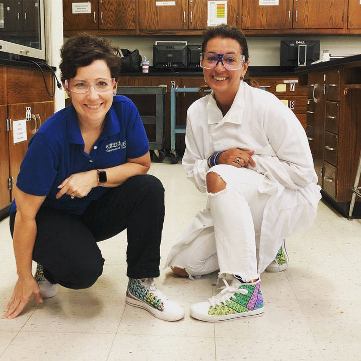Professor and student pose with matching Periodic Table printed shoes