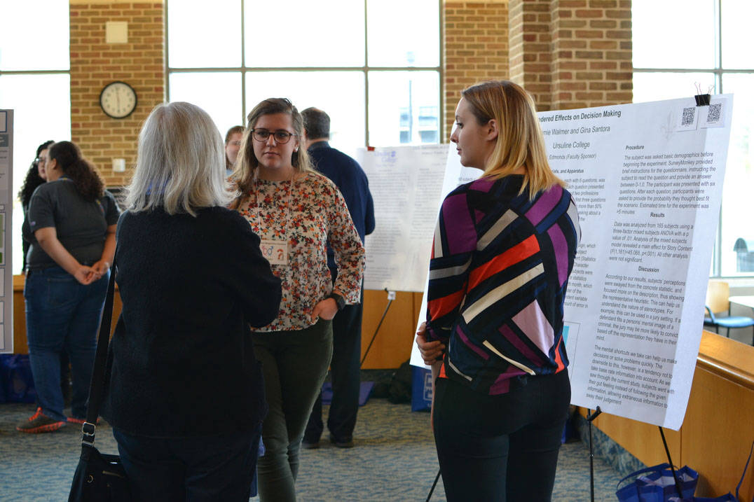 Students discuss work at Student Research Symposium