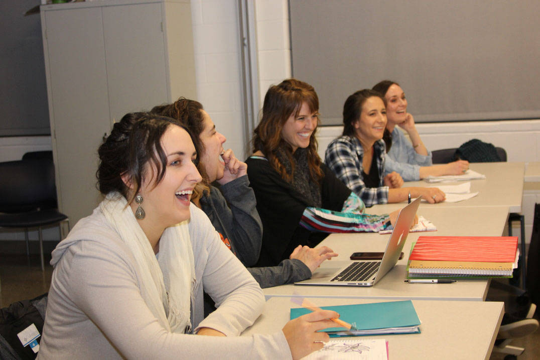 Five students laugh while in class