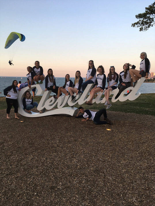 Students at Cleveland sign at Edgewater Park Beach