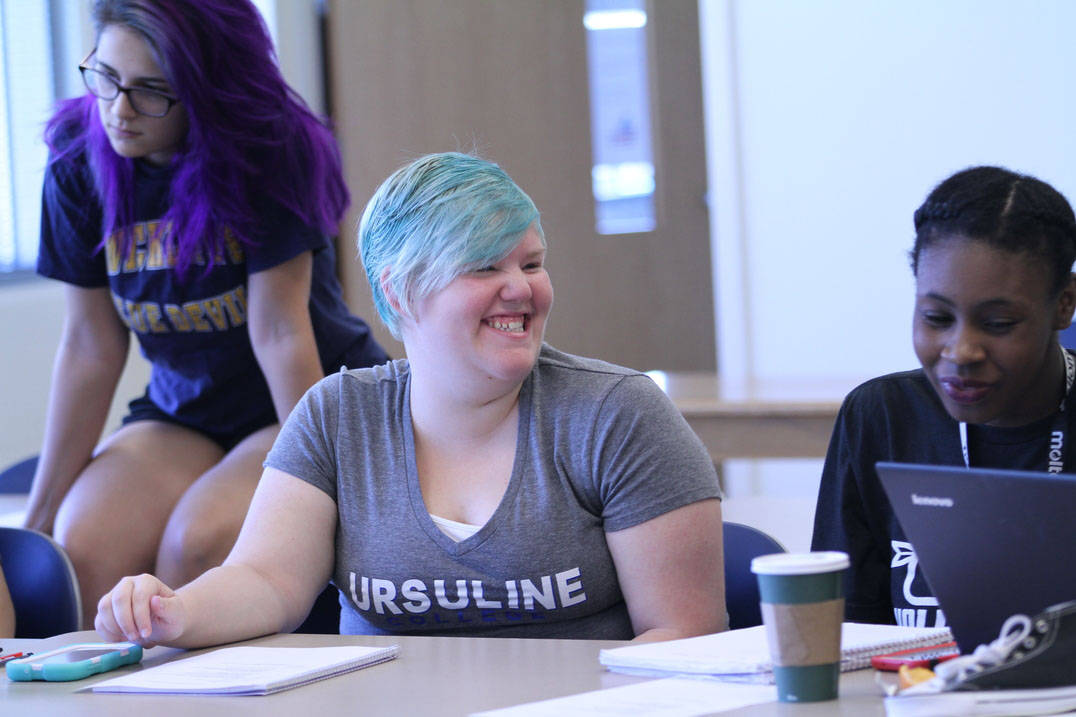 Student smiles during class
