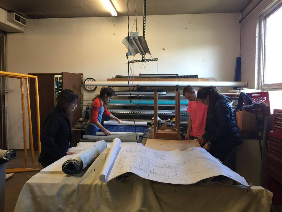 Historic preservation students examine blueprints