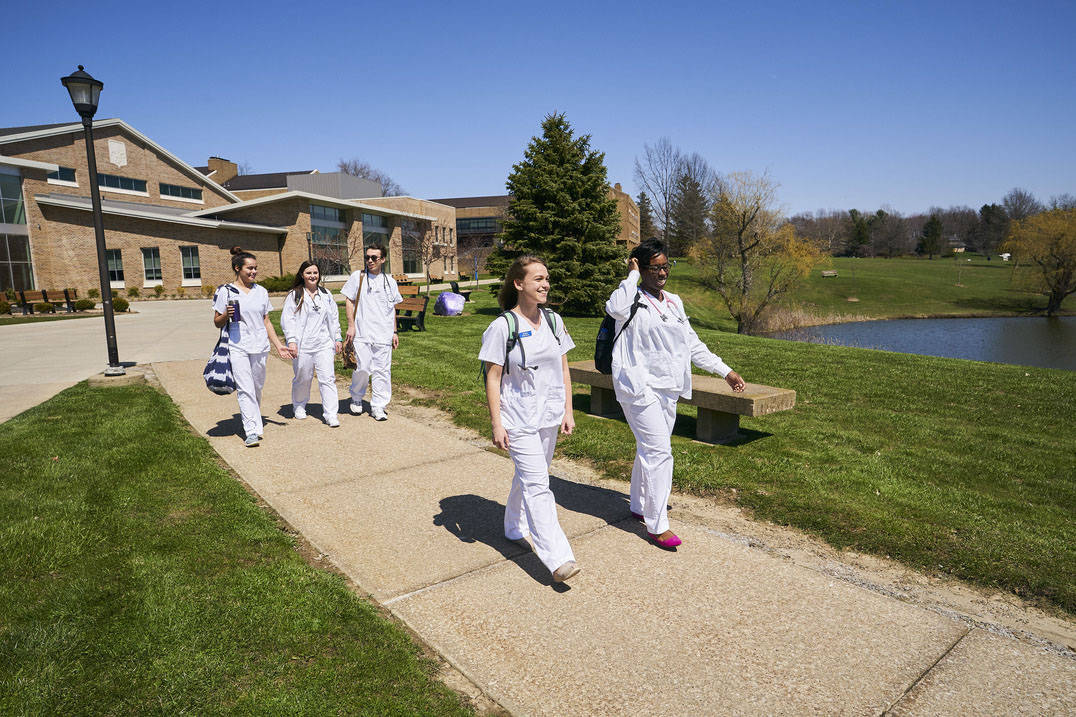 Nursing students walking on campus
