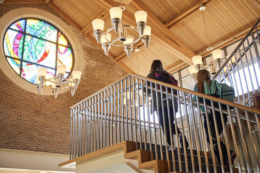 Students ascend the staircase in the Pilla Atrium.