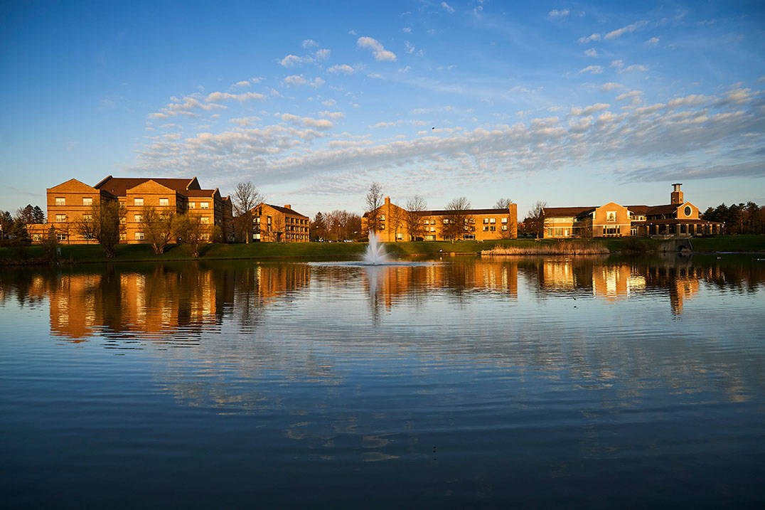 A view of Lake Elsa and Ursuline's three residence halls.