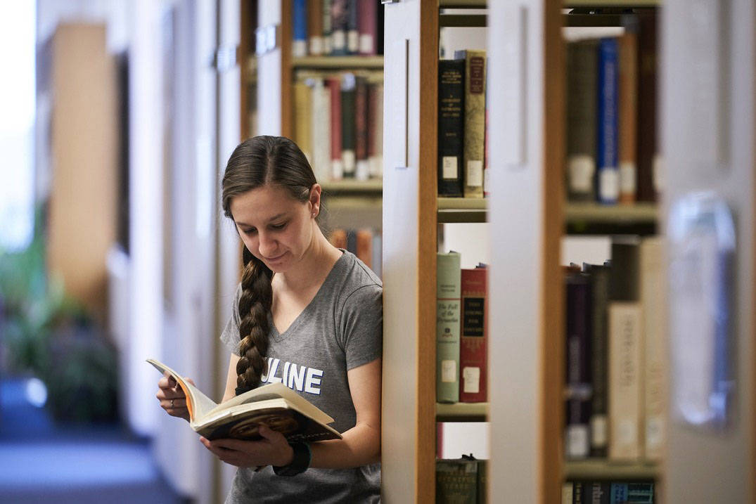 A student reads a book at Ursuline College Library