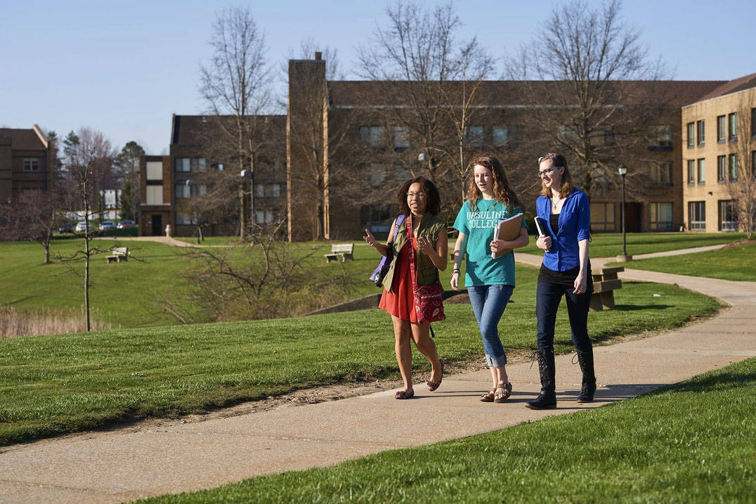 Friends enjoy a walk across campus.