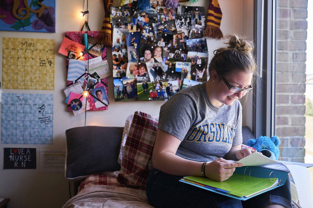An Ursuline student studies in her residence hall.