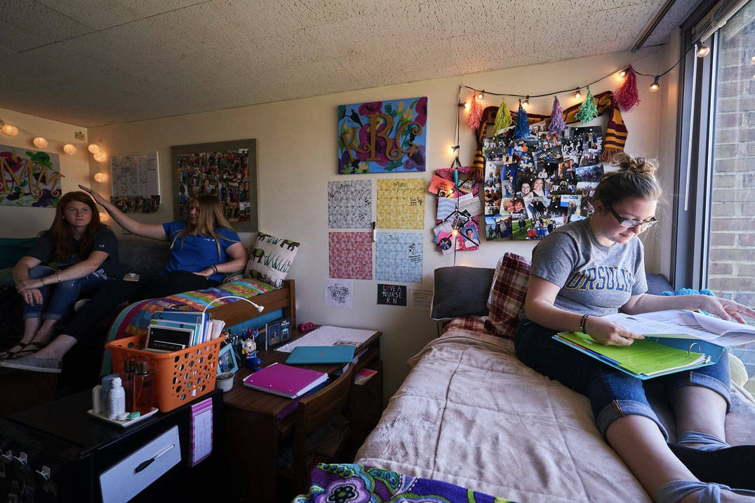Roommates study in their residence hall room at Ursuline College