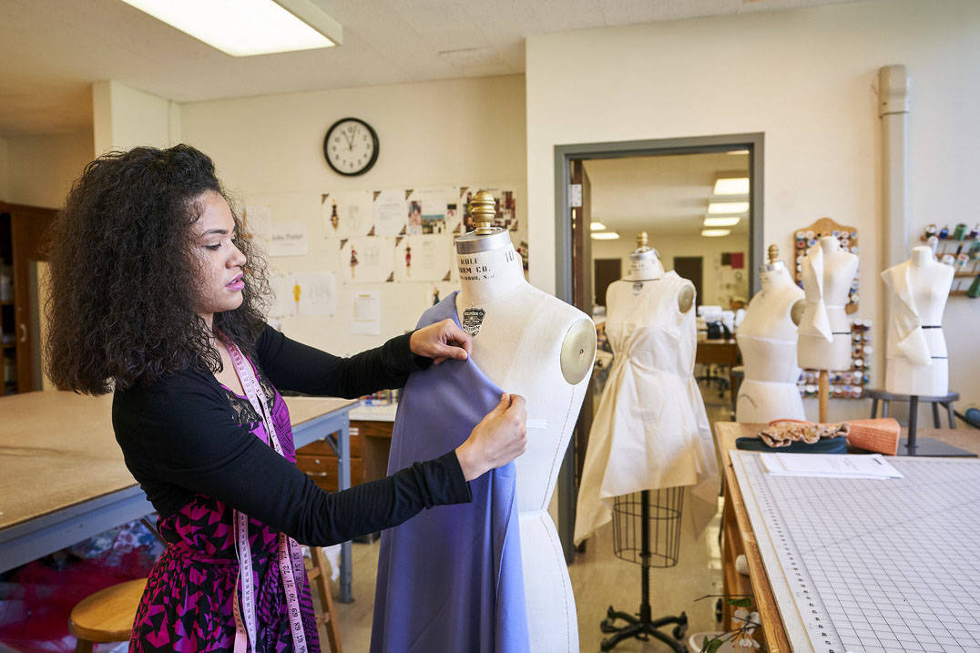 A fashion design student busy at work.