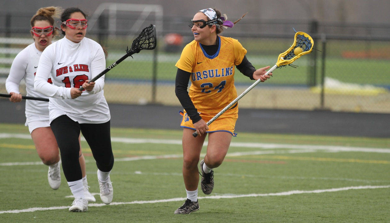 Ursuline Arrows Lacrosse player prepares for a pass