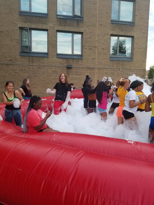 Ursuline Students play with bubbles
