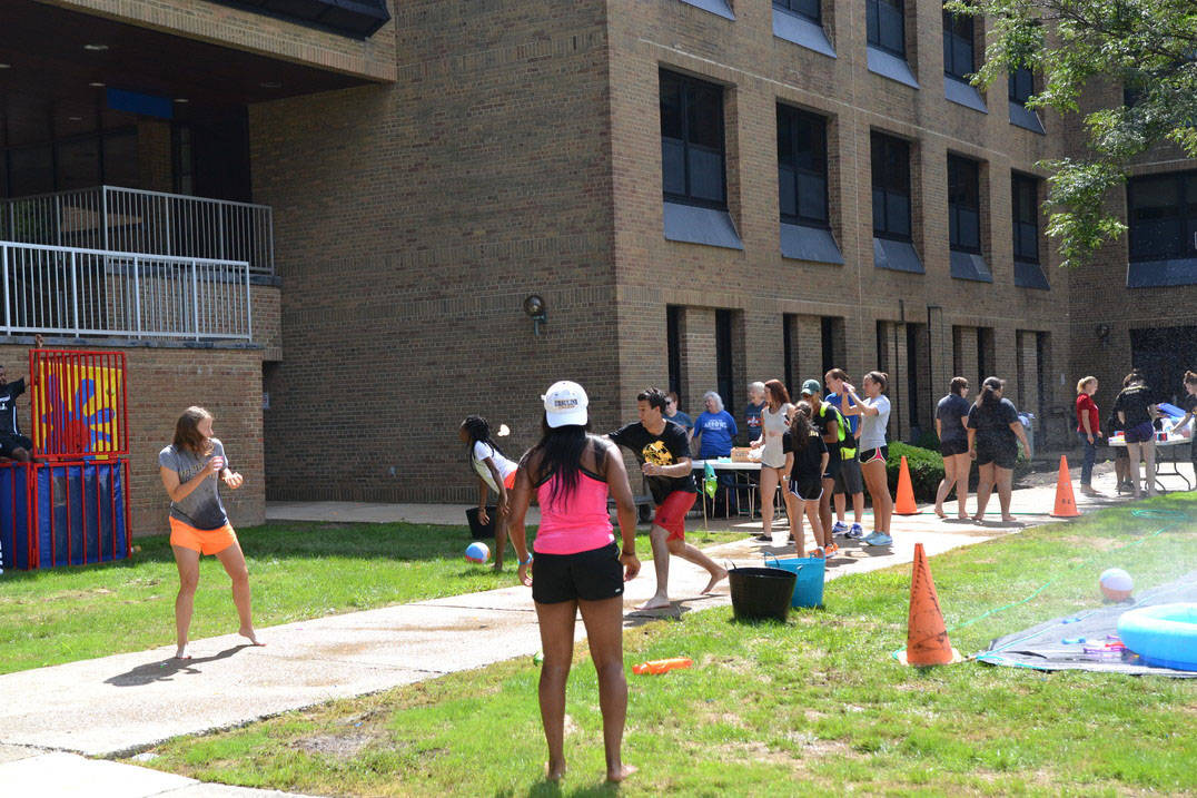 Ursuline students have a water balloon fight on the Quad