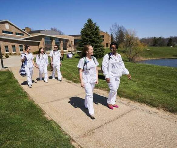 Accelerated second degree nursing students walking on campus