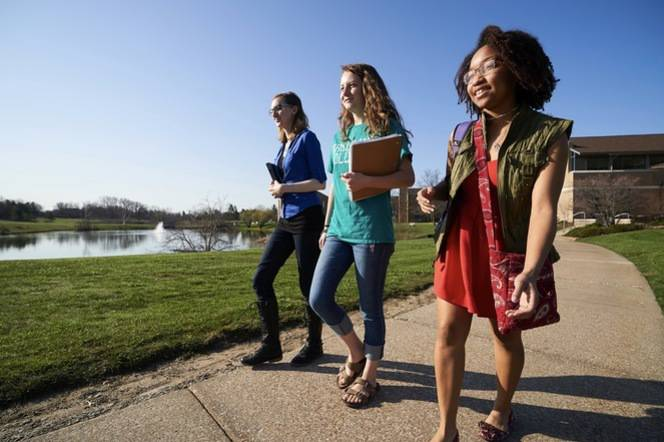 Ursuline students walking to class on a sunny day.